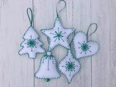 Set of 5 lovely handmade felt Christmas decorations featuring in white and green colors, ready to be hung on your Christmas tree or as a decoration anywhere in the room. It is a handmade item with great care to precision and quality, approximate size: 10 cm. Please note it is only #feltcrafts