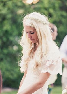 Simple boho wedding dress with lace sleeves. Pretty understated floral crown. Gorgeous, modest & fresh.