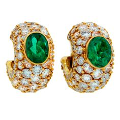 Classy and colorful hoop earrings created by BULGARI in Italy in the 1980's. Feature oval Colombian emeralds accented with round diamonds set in yellow gold.  Splendid yet wearable - great for day-wear and nightwear, with casual or dressy outfit. Finest quality emeralds and diamonds. - 40k USD