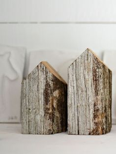 Natural wood as sculpture- the rough bark and colors.