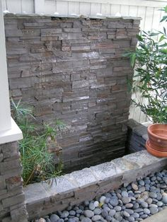 Transform any setting into a peaceful and relaxing space with the addition of any of our beautiful outdoor water fountains and water walls. Create a beautiful backyard by adding a garden water feature. A collection of waterwall feature elements in the landscape built by Enviroscape LAin Los Angeles, Redondo Beach and Manhattan Beach Back yard. Small, functional, and cozy! click the thumbnail images below to increaase the