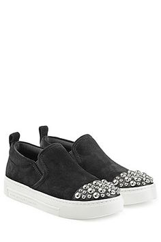 Sprinkled with silver-tone stud embellishment, these coal black suede slip-on sneakers are an urban but glossy choice from Marc by Marc Jacobs #Stylebop