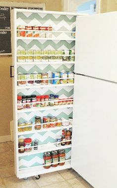 The fridge pull out storage idea by Classy Clutter - smaller and more artsy