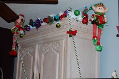 Whoville garland with lots of bright colored ornaments. Elves and candy canes. Fun decor.