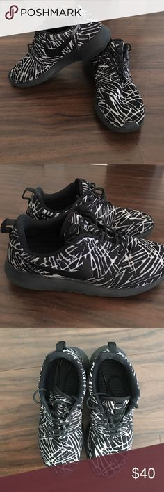 Nike black and white print sneakers- size 8.5 Moderately worn but in great condition. Slight pulling on the ankle area but not noticeable. Comes with sneakers deodorizers. Nike Shoes Sneakers