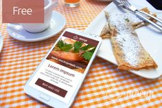 A free photorealistic free PSD Samsung Note 2 mobile mockup with pancake and coffee on table.