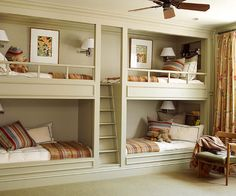 Modern BunkhouseA built-in wall of bunks joyfully accommodates sleepovers and sibling gatherings in this spacious playroom. Bookshelves and wiring for reading lights were thoughtfully planned into each sleeping cove.