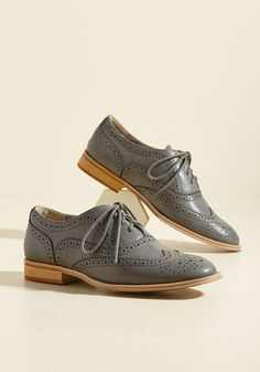 And now for your feature presentation - these grey wingtips! Totally classic, these retro, faux-leather kicks boast glossy soles, perforated details, and tons of personality.