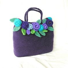 How to make this Crochet Felted Flower Bag Pattern Tutorial. You can download this tutorial shortly after you paid. Skill level : EASY beginner. Use : Your washing machine to felt ( shrink). Need : Wool Yarn & small crochet hook ( size J 6mm or similar). Details here: ★This