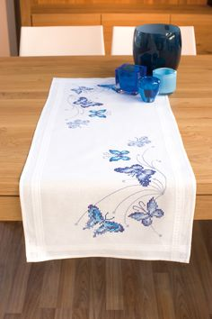 <img> Embroidery Cross Stitch Handicraft Vervaco butterfly blue table cloth decoration interior Source by vervacolanarte - Butterfly Print Dress, Butterfly Table, Blue Butterfly, Monarch Butterfly, Cross Stitch Embroidery, Embroidery Patterns, Cross Stitch Patterns, Embroidery Fabric, Yarn Organization