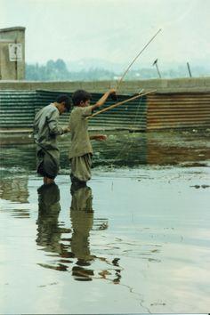 Pescatori sul lago Dal
