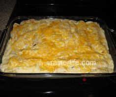 Absolutely wonderful Chicken Enchiladas with great instructions!!!Baking dish with chicken enchiladas topped with sour cream sauce and cheese.