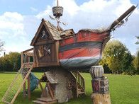 Daniels Wood Land Scallywag Sloop Outdoor Wood Tree Playhouse Now this is a tree house . Piscina Playground, Backyard Playground, Playground Design, Playground Ideas, Luxury Playhouses, Outdoor Playhouses, Bateau Pirate, Build A Playhouse, Wooden Playhouse