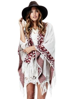 European inspired, the Anya shawl poncho is an ideal piece for the free spirited indie girl. The Anya features a fringed hem and an alpine snowflake design. 100% Acrylic Model is 5'7, garment is O/S.