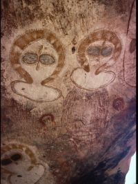 ancient cave painting;   showing more heads wearing protective helmets. Why were these protective helmets so common in ancient cave art?
