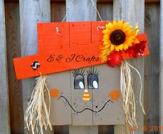 This adorable orange hatted scarecrow is a little girl...She is cute as a button, Decorated with lots of spray paint, acrylic paint, burlap, leaves,