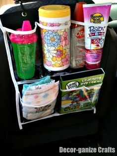 could use a shoe organizer and hang it from the back seat of van to store sun screen, band aids, wet ones, kleenex packets, small umbrella, paper towel, grocery sacks, etc.