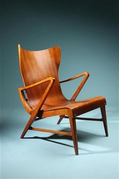 Armchair in mahogany plywood by Carl Axel Acking. Sweden, 1950's Very rare model. Pair available. Mahogany plywood