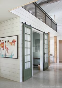Sliding barn door tips and tricks, including how to clean vintage hardware, paint around window panes, and the best barn door hardware for a fantastic price! pane ideas for office Green and Glass Sliding Barn Doors Double Sliding Barn Doors, Interior Sliding Barn Doors, Sliding Barn Door Hardware, Door Latches, Door Hinges, Barn Door In House, Barn Door Track, Diy Barn Door, Barn Door With Window