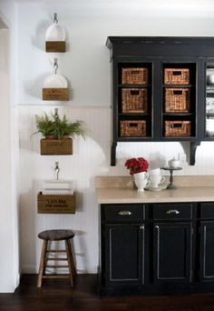 Why Painting Your Cabinets Is a Smarter Alternative To Buying New: Black Painted Kitchen Cabinets