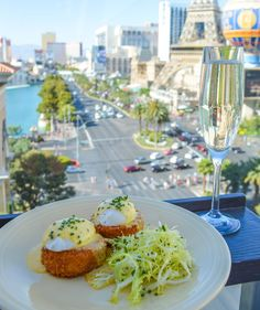 Enjoy fresh crab cakes with marinated navy beans and mustard emulsion from Estiatorio Milos. Pair with their signature cocktail Clean Sweep for the perfect lunch. #VegasEats