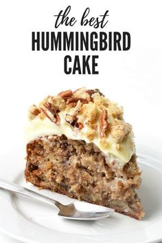 The most delicious Hummingbird Cake. It's soft and moist filled with bananas, pecans and pineapple and covered with cream cheese frosting and pecan cookie crumbs. Recipe on sweetestmenu.com