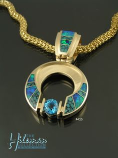 Australian opal and turquoise pendant with Swiss blue topaz handcrafted in yellow gold by The Hileman Collection. Beautiful blue-green Australian opal alternating with amazing spiderweb turquoise inlay. Australian Opal Jewelry, Pendant Design, Opal Earrings, Turquoise Pendant, Sterling Silver Pendants, Blue Topaz, Blue Green, Yellow, Jewelry Design