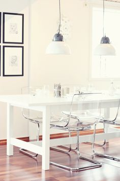 Clear chairs lighten small space. Norden white table, tobias chairs