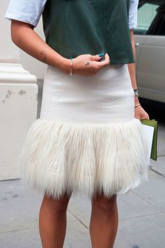 We love this leather and fur skirt spotted during LFW via @stylelist | http://aol.it/1uTMBt1