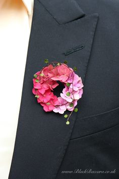 Delicate soft pink hydrangea boutonniere with trailing muehlenbeckia vine . This would perfectly complement a bride's floral crown of pretty pink summer flowers. www.blackbaccara.co.uk