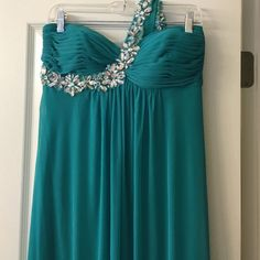 Evening gown prom dress A beautiful teal green, more in green side then blue. One shoulder strap of gorgeous diamond like stones. 100%polyester. Worn once in great condition Xscape by Joana Chen Dresses Maxi