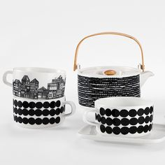 A relaxed black and white Skandium Marimekko ceramic tableware, with intricate town illustrations and bold geometrical elements. Perfect for a relaxed jet flight? Marimekko, Ceramic Tableware, Glass Ceramic, Kitchenware, Monochrome Interior, Scandinavian Interior, Contemporary Cushions, Dining Ware, Home And Deco