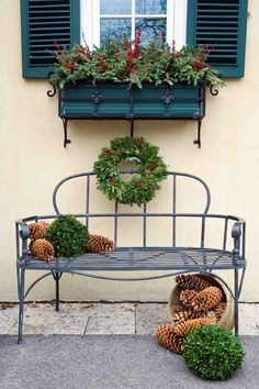 """Put a bench to work on the off-season: give it holiday spirit with an arrangement of holiday greenery, pinecones, gazing balls, and ornaments."" Holiday Outdoor Decorating Tips from Mariani Landscape - Traditional Home® Noel Christmas, All Things Christmas, Natural Christmas, Christmas Vignette, Christmas Greenery, Christmas Porch, Simple Christmas, Outside Xmas Decorations, Outdoor Decorations"