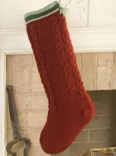 Cabled Christmas Stocking | AllFreeKnitting.com This printable Christmas stocking pattern will get you in the holiday spirit. Knit the Cabled Christmas stocking for a holiday decoration that you'll always treasure.