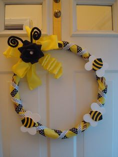 Bee Party- wreath. Can you beeee-lieve I got this big sized wreath at the dollar store? Then I used yellow ribbon from there too, plus bees from Michaels, and the rest I had on hand from the other projects! eb