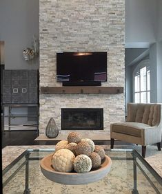 11 Stone Veneer Fireplace Surround Design Trends & Where To Buy – Stone fireplace living room Modern Stone Fireplace, Fireplace Accent Walls, Fireplace Feature Wall, Stone Veneer Fireplace, Stone Fireplace Designs, Feature Wall Living Room, Stone Fireplace Surround, Stacked Stone Fireplaces, Stacked Rock Fireplace