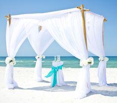 bamboo arbor with white chiffon beach wedding gin Destin Florida