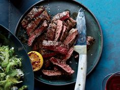 Learn to make this delicious grilled steak, with spicy peppers and a salad with smoky lemon dressing, at Food & Wine. Skirt Steak Recipes, Grilled Steak Recipes, Grilled Meat, Grilling Recipes, Meat Recipes, Wine Recipes, Cooking Recipes, Healthy Recipes, Pepper Recipes