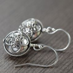 Bali earrings with rounded sterling silver discs.  Bead size: 12mm  Total length: 1 inch  Materials: Sterling Silver  Matching Jewelry