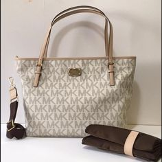 🎉firm sale🎉Michael Kors Diaper Bag NWT Brand new with tags Michael Kors Diaper Bag from the Jet Set Collection. 20inches across, 7 inches depth and 12 inches tall. Includes diaper changing pad, detachable strap to turn bag into a crossbody hands free, and includes Michael Kors shopping bag.                                    Sold out in stores.NO Trades‼️‼️         👇🏼👇🏼👇🏼offers appreciated thru the offer button👇🏼👇🏼👇🏼. MICHAEL Michael Kors Bags Baby Bags