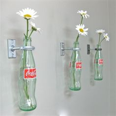 Good idea for our old bottles!  Hang them on my fence!  Crafts Using Glass Coke Bottles   Crafts Using Glass Coke Bottles - Bing Images