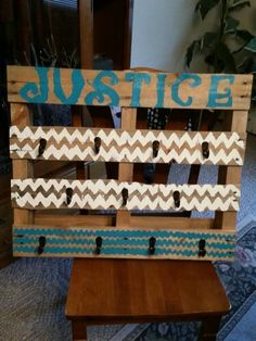Pallet craft! Took a small pallet, some paint & stencils and made a coat hanger!