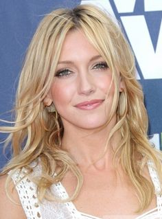Katie Cassidy's Long, Center-Parted Curly Hairstyle