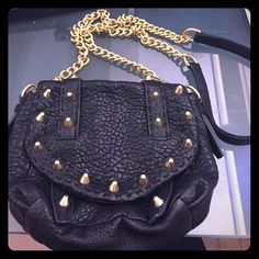 Rebecca Minkoff crossbody Soft leather. Black with gold studs and strap. Never worn and in perfect condition!!! Rebecca Minkoff Bags Crossbody Bags