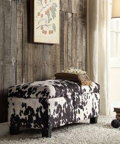 rustic wood wall + cowhide ottoman
