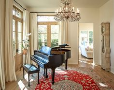 Houston Residence by Thompson Custom Homes - love the windows and the floor with a rug