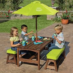 kids picnic table & benches with umbrella from One Step Ahead. I love the size and the umbrella to keep the sun off of Sam Picnic Table With Umbrella, Picnic Table Bench, Table And Bench Set, Kid Table, Play Table, Kids Outdoor Furniture, Kids Furniture, Preschool Furniture, Rustic Furniture