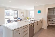 The kitchen with adjoining scullery. You can cook and entertain at the same time with this open plan living space.