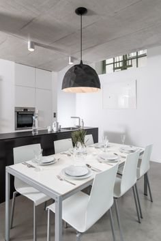 white dining table and black kitchen