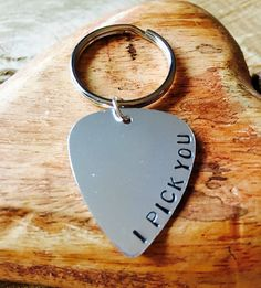 A personal favourite from my Etsy shop https://www.etsy.com/uk/listing/274094820/guitar-pick-keyring-i-pick-you